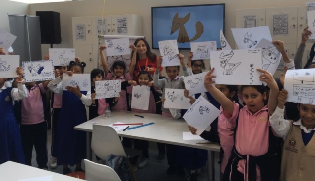 A class holding up their foxes and other characters