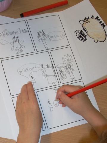 A pupil creating a comic strip