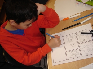 Child creating a comic strip