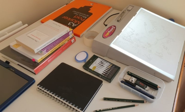 Illustrator, Emily Fellah's desk, drawing materials and light box
