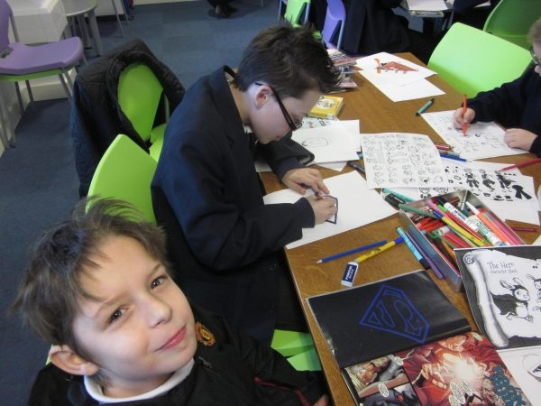 Pupils drawing at a comics and graphic novels workshop with Brown's School