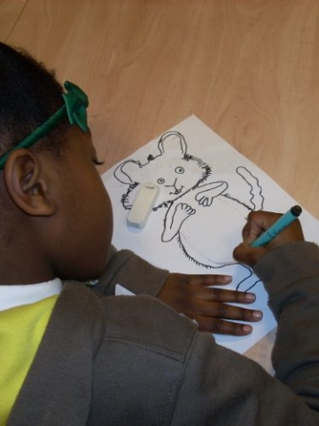 Girl drawing Ishmael Mouse at a Kate Greenaway Medal workshop