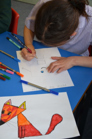 A girl creating a character in a workshop.