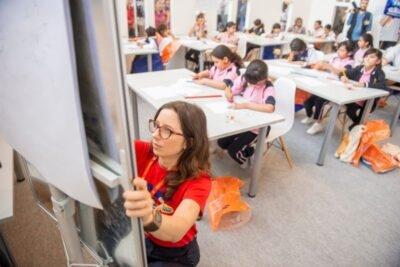 Pupils partaking in a drawing tutorial at Sharjah International Book Fair