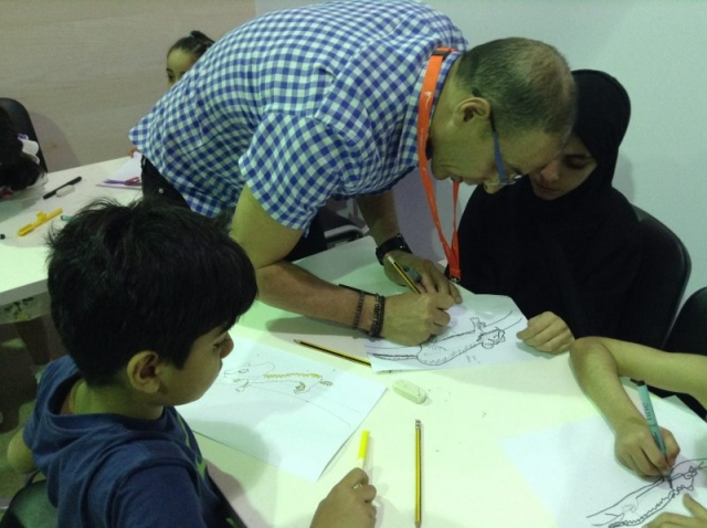 Mustapha helping children draw lions