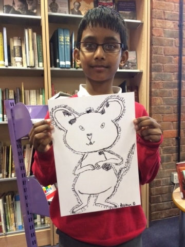 Boy with his Ishmael Mouse drawing