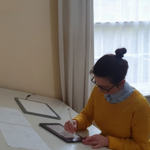 Emily working at her desk