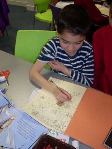 Boy creating a comic strip
