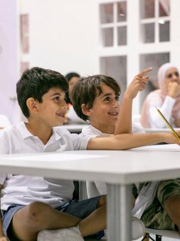 Children enjoing a comics workshops